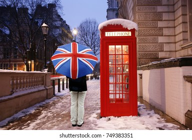 London Red Telephone Booth, people with Union Jack Umbrella present