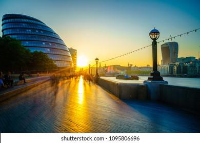 London riverside walkway with sunset flare