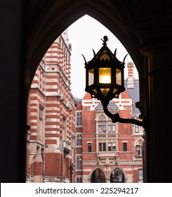 London Royal Courts of Justice Buildings through Arch and Street Lamp