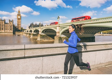 London runner woman running near Big Ben. Europe city Asian girl jogging training at Westminster bridge with red double decker bus. Fitness athlete happy in London, England, United Kingdom.