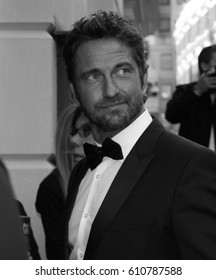 LONDON - SEP 02, 2014: Gerard Butler ( Image digitally altered to monochrome ) attends the GQ Men of the Year awards at The Royal Opera House on Sep 02, 2014 in London