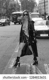 London - SEP 14, 2018: ( Image digitally altered to monochrome ) Member of the public poses for Street fashion at Spring Summer 2019