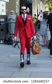 LONDON - SEP 17, 2018: Member of the public poses for Street fashion at Spring Summer 2019, London Fashion Week