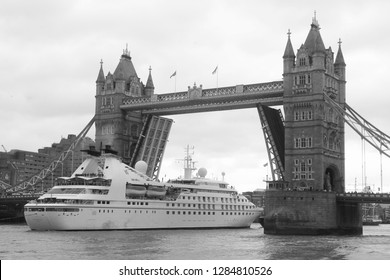 LONDON - SEP 20, 2018: ( Image digitally altered to monochrome ) Tower Bridge lifts for the luxury liner Star Breeze to pass through