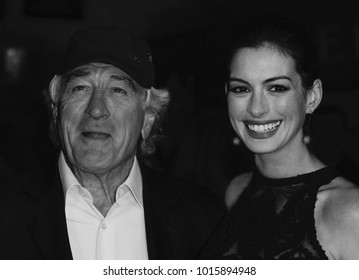 LONDON - SEP 27, 2015: ( Image digitally altered to monochrome ) Anne Hathaway and Robert De Niro attend The Intern film premiere in London