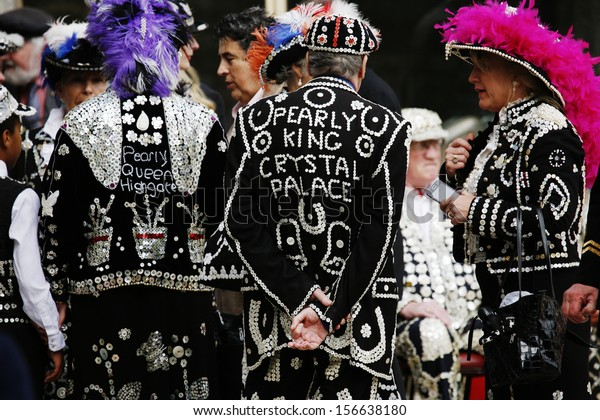LONDON - SEP 29 : Participants at 2013 Pearly Kings and Queens, wearing clothes decorated with pearl, charitable tradition of working class culture, Harvest Festival on Sep 29, 2013, London, UK.