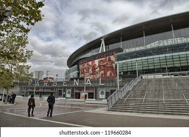 LONDON - SEP 30. Exterior of Arsenal FC Emirates Stadium, result of the Arsenalisation project depicting four Arsenal legends linking arms on September 30, 2012 in London, England