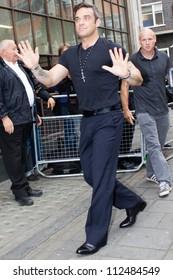 LONDON - SEPT 10: Robbie Williams visits BBC Radio One, Sept 10, 2012 in London, UK