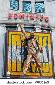 """LONDON - SEPT 12: The statue of Freddie Mercury above the West End's Dominion Theatre in London on September 12, 2010. Dominion Theatre is home to hit musical """"We Will Rock You""""."""