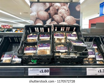 LONDON - SEPTEMBER 1, 2018: Mushrooms for sale on the shelves at Sainsbury's supermarket in London, UK.