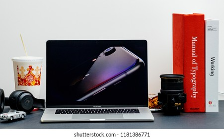 London - September 13, 2018: Apple Computers internet website on 15 inch 2018 MacBook Retina in room environment showcasing iPhone Xr presentation to public