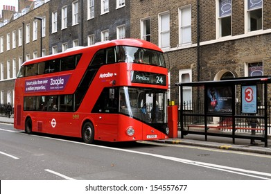 LONDON - SEPTEMBER 16. London's new Routemaster hybrid double deck bus with three doorways and two staircases accommodates 80 passengers; September 16, 2013, at bus stop in Bloomsbury, London, UK.
