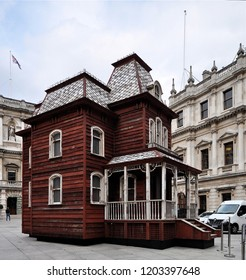LONDON - SEPTEMBER 18, 2018. Transitional Object (PsychoBarn) is Cornelia Parker's installation commissioned by The Metropolitan Museum of Art, NY, seen here in the Royal Academy courtyard, London