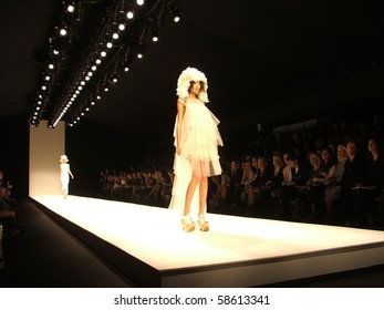 LONDON - SEPTEMBER 19: A model walks the runway for the John Rosha Spring/ Summer Collection 2010 at London Fashion Week on September 19, 2009 in London