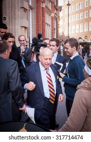 LONDON - SEPTEMBER 20, 2013: UKIP MEP, Geoffrey Bloom, storms off after being questioned by the media in reference to sexist comments he made on September 20, 2013.