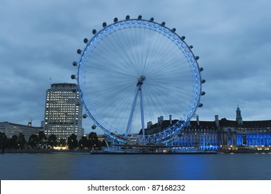 LONDON - SEPTEMBER 20: The London Eye is lit up at night on Sept. 20, 2011 in Londong England. It is a 135-metre (443 ft) tall giant Ferris wheel situated on river Thames, visited by over 3.5 million people annually.
