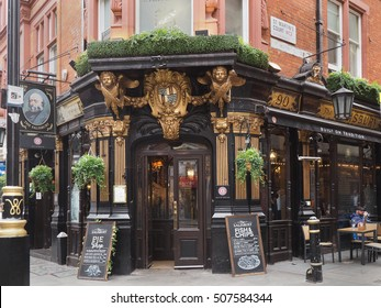 LONDON - SEPTEMBER 2016:  Many pubs are elaborately decorated, but this one in the theater district of St. Martin's lane stands out, as seen in London circa September 2016.