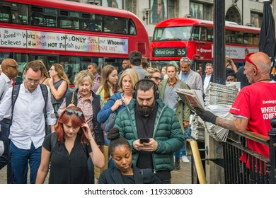 LONDON- SEPTEMBER, 2018: Crowds of shoppers on a busy Oxford Street with red London buses- a famous London street with many fashion shops