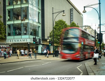 LONDON- SEPTEMBER, 2018: Debenhams flagship store on Oxford Street with motion blurred people and traffic