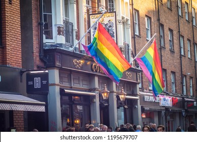 LONDON- SEPTEMBER, 2018: Gay pride flags flying outside a bar in Soho in London's west end .