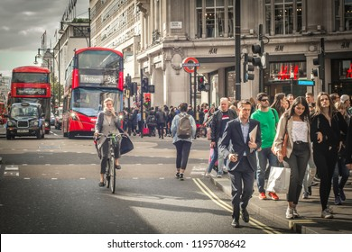 LONDON- SEPTEMBER, 2018: Shoppers on Oxford Street, a world famous fashion retail location and vibrant London landmark