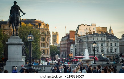 LONDON- SEPTEMBER, 2018: View of people in Trafalgar Square with the houses of Parliament in the background, a historic part of London and popular tourist spot