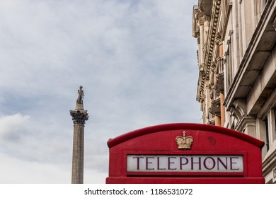 London. September 2018. A view of a red phone box and Nelsons column in the background in Westminster in London