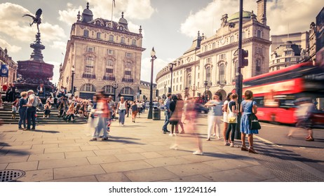 LONDON- SEPTEMBER, 2018:  Wide angle view of Piccadilly Circus with a motion blurred red double decker bus- a famous London landmark in London's West End