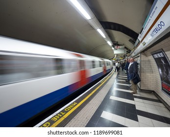 London - September 21, 2018: Train speeding up in city subway, London underground, public subway, Waterloo station. London, September 21, 2018, England
