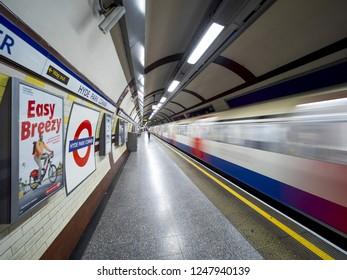 London - September 21, 2018: Train speeding up in city subway, London underground, public subway, Hyde park corner. London, September 21, 2018, England