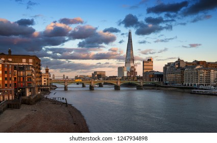 LONDON - September 21, 2018:London at sunset, view from Millennium Bridge, The Shard, Tower Bridge, Southwark Bridge. London, UK