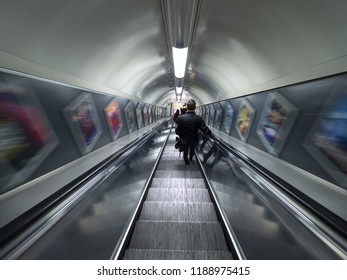 London - September 22, 2018: People on Escalator Motion Blurred, London underground, public subway, oxford circus station. London, September 22, 2018, England