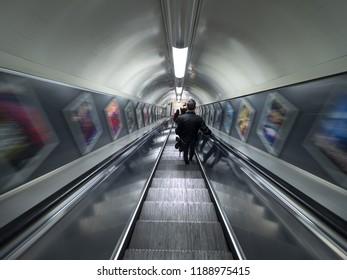 London - September 22, 2018: People on Escalator Motion Blurred, London underground, public subway, oxford circus station. London, September 22, 2018, England