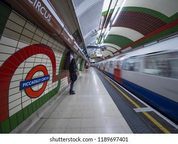 London - September 22, 2018: Train speeding up in city subway, London underground, public subway, Piccadilly cirkus. London, September 22, 2018, England