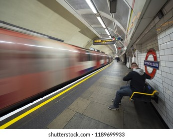 London - September 22, 2018: Train speeding up in city subway, London underground, public subway, Notting hill gate. London, September 22, 2018, England