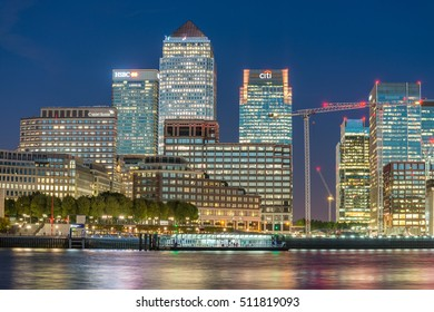 LONDON - SEPTEMBER 25, 2016: Canary Wharf buildings along river Thames. Canary Wharf is the city business district.