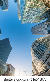 LONDON - SEPTEMBER 25, 2016: Canary Wharf buildings upward view from the street. Canary Wharf is the city business district.
