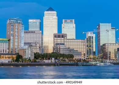 LONDON - SEPTEMBER 26, 2016: Skyline of Canary Wharf business district. London attracts 30 million people annually.