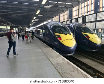 "LONDON - SEPTEMBER 3, 2017: Passengers board British Rail Class 395 ""Javelin"" High Speed Trains manufactured by Hitachi at St Pancras International Train Station in London, UK."