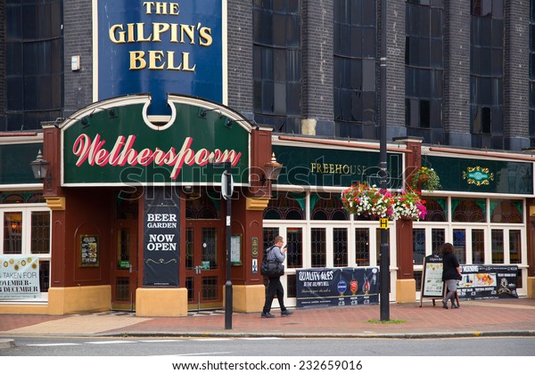 LONDON - SEPTEMBER 5TH: The exterior of the Gilpin's Bell Pub on September the 5th, 2014, in London, England, UK. Wetherspoon's is the uk's biggest pub chain.