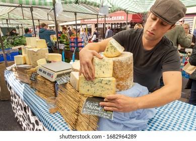 LONDON - SEPTEMBER 7, 2013: English Blue Stilton cheese for sale at Broadway Market, Hackney