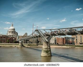 London skyline with Millenium bridge seen from Thames, UK