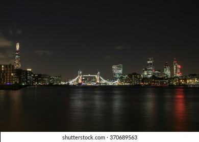 London skyline at night, showing the City of London, Tower Bridge and the Shard.