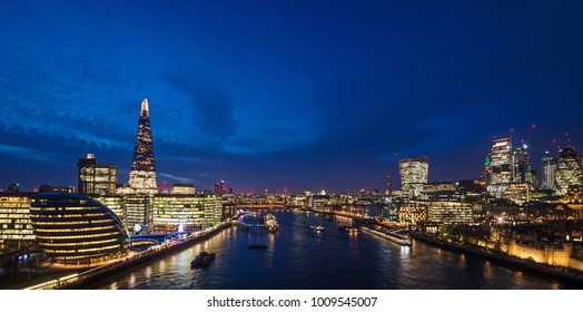 London skyline on Thames river at dusk.