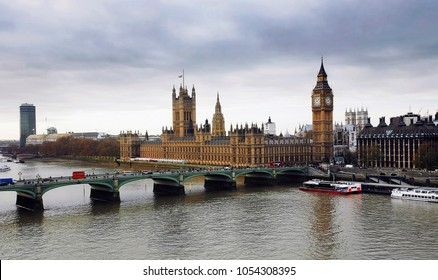 London skyline overlooking various landmarks and Thames River. Image include Westminster Palace, Big Ben, Westminster Bridge, Lambeth Bridge and Routemaster Bus.