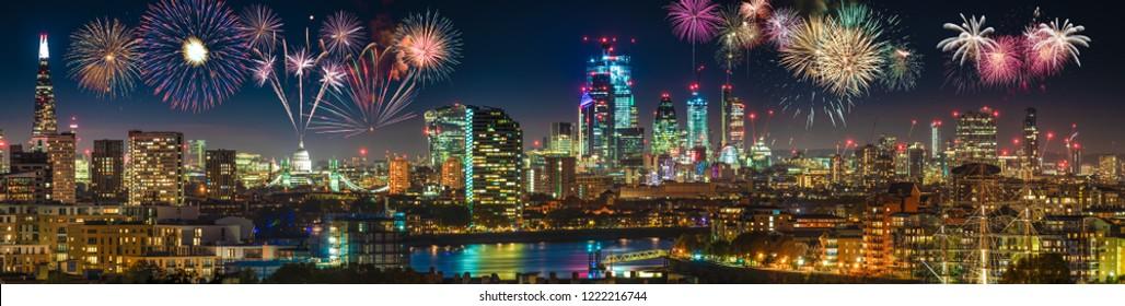 London skyline panorama at night with fireworks display