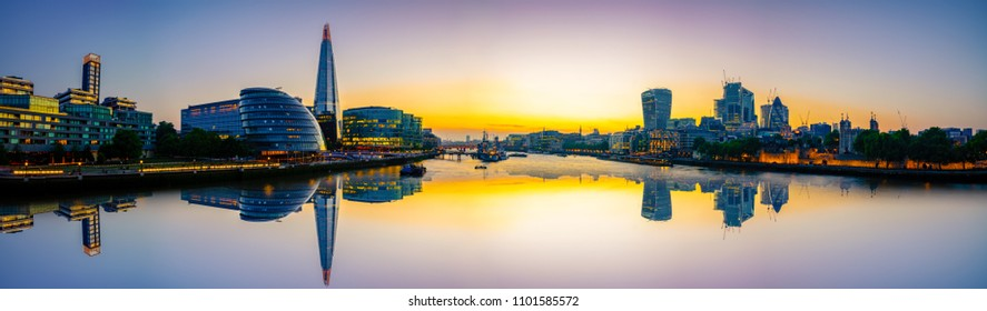 London skyline panorama with reflection at sunset