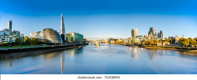 London skyline panorama with reflections viewed from the Tower Bridge