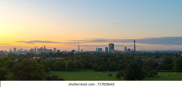 London Skyline seen from Primrose Hill, Regent's park during the morning golden hour