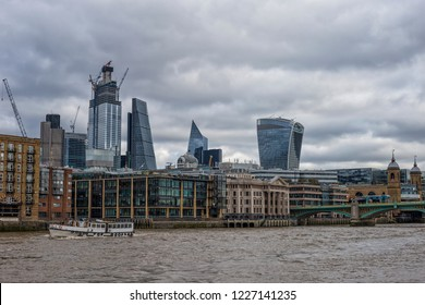 London skyline seen from the River Thames on a beautiful cloudy day, London